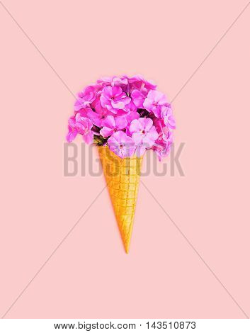 Ice Cream Cone With Flowers Over Colorful Pink Background Top View