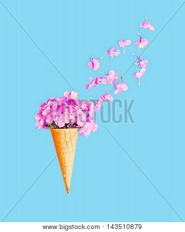 Ice Cream Cone With Petals Flowers Over Blue Background Top View