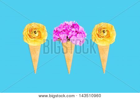 Three Ice Cream Cone With Flowers Over Blue Colorful Background Top View