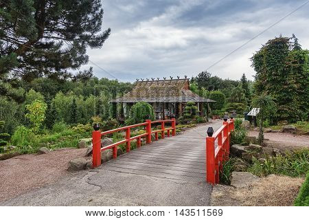 Japanese garden elements of traditional red bridge.