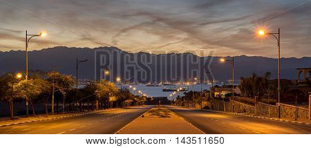 Scenic view on the Red Sea and Jordanian mountains from a street in Eilat, Israel