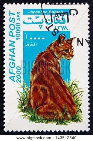 AFGHANISTAN - CIRCA 2000: a stamp printed in Afghanistan shows Japanese Bobtail Domestic Cat circa 2000