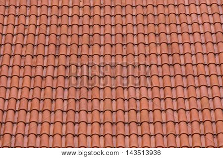 Closeup of the red clay roof tiles as a background