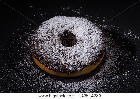 Sprinkling Sugar Powder On Chocolate Donut