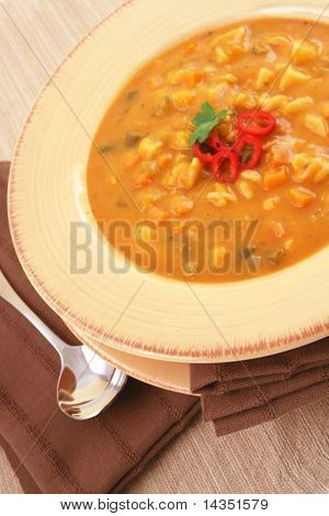 Minestrone vegetable soup with pasta spirals.