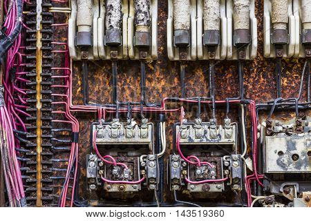 Old Rusted Electrical Panel with Fuses and Contacts in an Abandoned Automobile Factory III