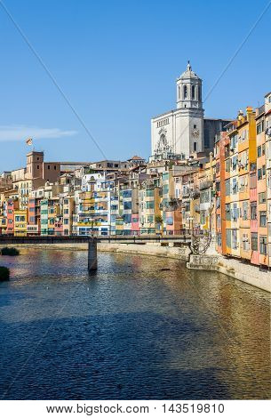 Onyar river crossing the downtown of Girona with Santa Maria cathedral in background. Gerona Costa Brava Catalonia Spain.