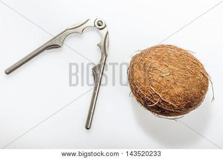 Nutcracker used to try in vain to break a coconut isolated on white background