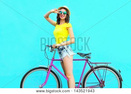 Fashion Pretty Smiling Woman On Retro Pink Bicycle Over Colorful Blue Background