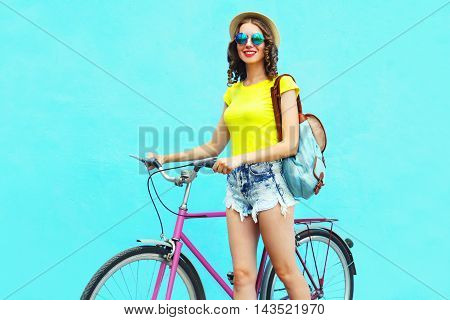 Fashion Pretty Smiling Young Woman With Bicycle Over Colorful Blue Background In Summer Day