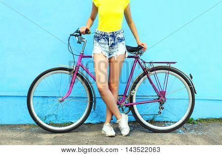 Fashion Pretty Woman And Bicycle Over Colorful Blue Background