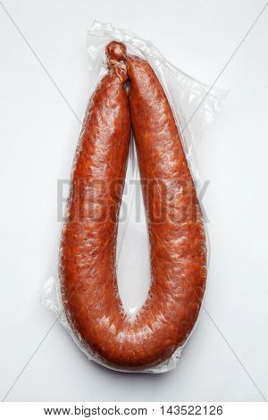 Sausages In Vacuum Pack Isolated On Gray Background