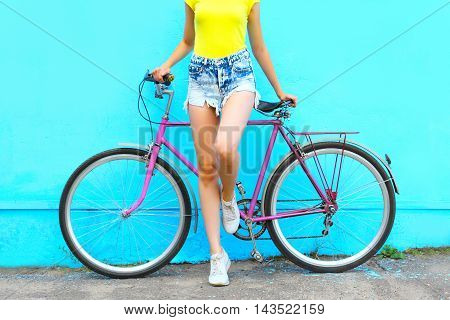 Fashion Pretty Woman On Bicycle Posing Over Colorful Blue Background