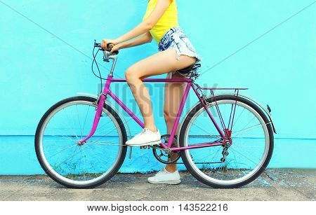 Fashion Pretty Woman With Bicycle Over Colorful Blue Background In Profile