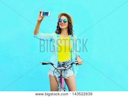 Pretty Cool Young Woman Taking Self Portrait On Smartphone With Retro Bicycle Over Colorful Blue Bac