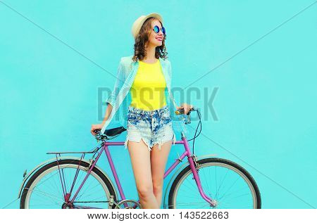 Pretty Smiling Woman With Bicycle Over Colorful Blue Background In Profile