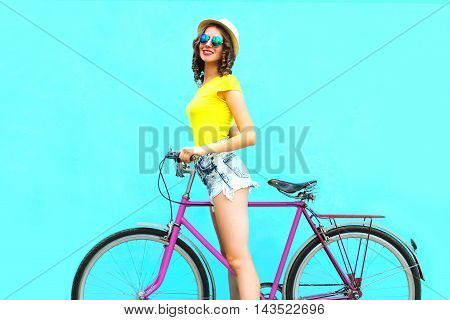Pretty Fashion Smiling Woman With Retro Pink Bicycle Over Colorful Blue Background