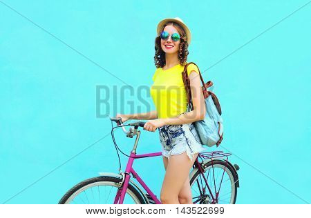 Pretty Smiling Woman With Bicycle Over Colorful Blue Background