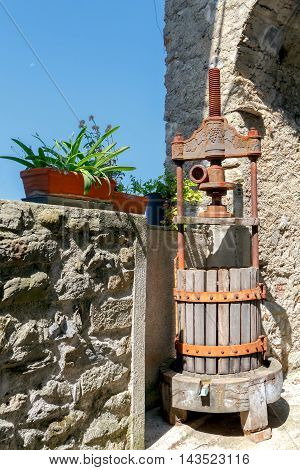 Traditional press for making wine from the grapes in Liguria. Italy.