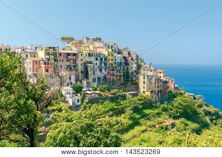 View of the colorful houses facades of the traditional medieval Italian village Corniglia. Cinque Terre. Italy.