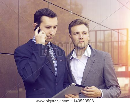 Two Businessman Looking At Tablet. The Success Of The Work Of Professionals.