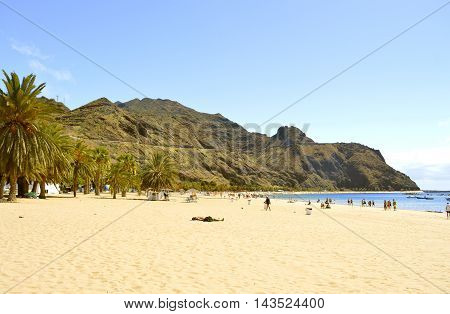 Playa De Las Teresitas beach Tenerife Canary Islands Spain Europe - June 14 2016: Tourists on the beach enjoying the sun