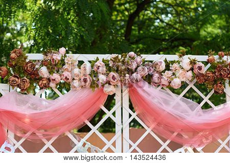 wedding arch decorated with flowers in the garden for the ceremony.