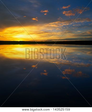 Beautiful golden sunset over a mountain lake.