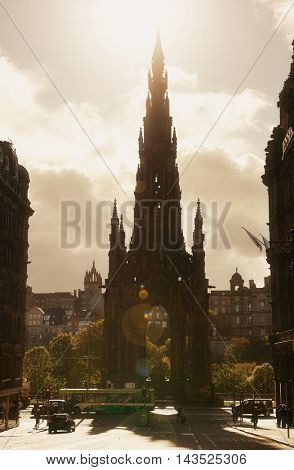 EDINBURGH, UK - OCT 8: Scott Monument with street view on October 8, 2013 in Edinburgh. As the capital city of Scotland, it is the largest financial centre after London in the UK.