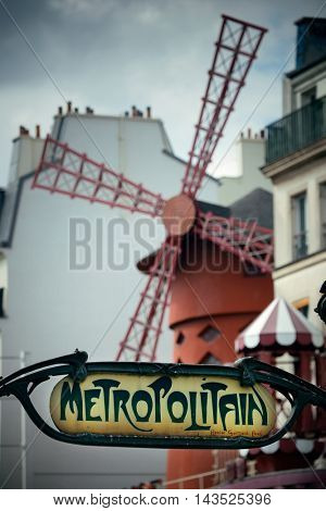 PARIS, FRANCE - MAY 13: Metro station and Moulin Rouge street view on May 13, 2015 in Paris. It is the most-visited paid monument in the world with annual 250M visitors.
