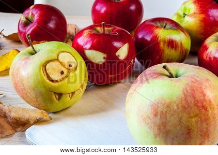 Creepy and funny monsters of apples for the children's party on Halloween