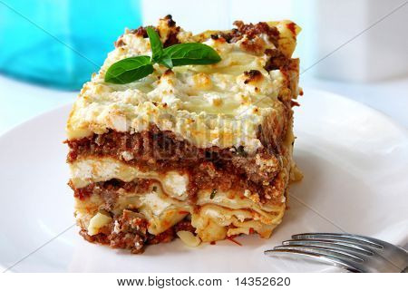 Lasagne, home-baked, with layers of meat sauce, mozzarella, ricotta and parmesan cheeses.