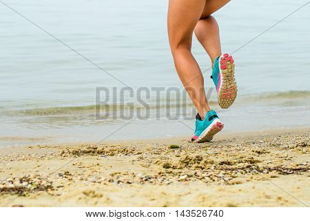Beautiful Sporty Girl On The Beach