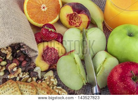 Fruits and nut mix - Fruits and nuts background with a mix of apples, oranges, bananas, peach, strawberries and different types of nuts, like walnuts, almonds, hazelnuts, raisins and cashew.