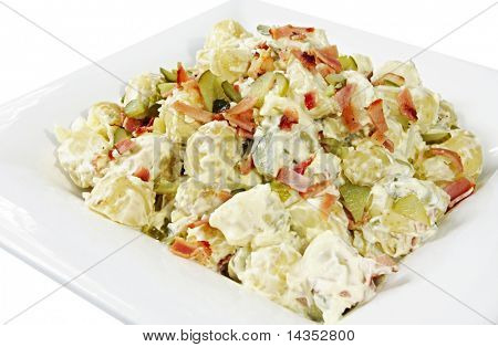 Potato salad with dill pickle, bacon, and a creamy dressing.  In a large serving platter.