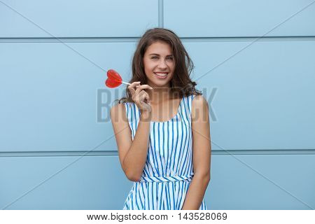 Outdoor Smiling Portrait Of Happy Young Beautiful Brunette Woman In Striped Summer Dress Posing With