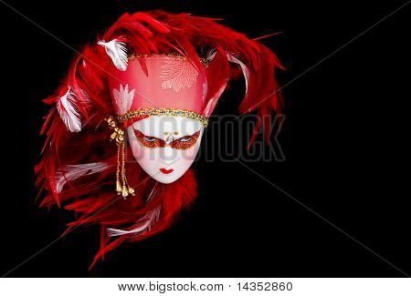 Venetian mask doll with vibrant red and white feathered headdress.