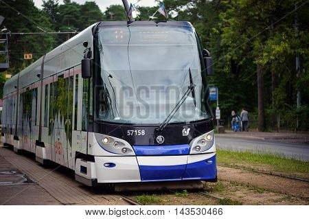RIGA, LATVIA - AUGUST 2016: Front view on Skoda 15 T ForCity Tram staying at tram staition of Riga town