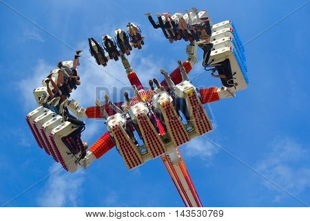CORTON, SUFFOLK, ENGLAND - AUGUST 16, 2016: Fair Ground  ride filled  with thrill seekers