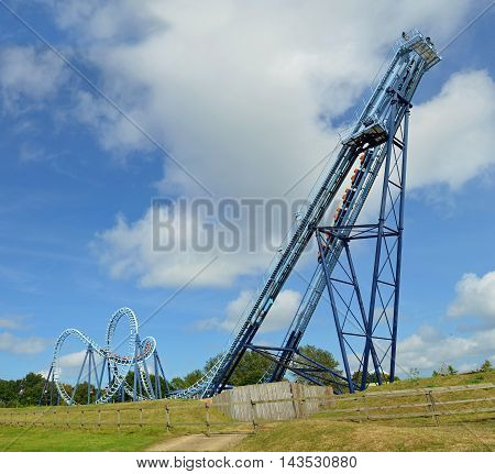 CORTON, SUFFOLK, ENGLAND - AUGUST 16, 2016: Roller coaster Wipeout  ride filled  with thrill seekers