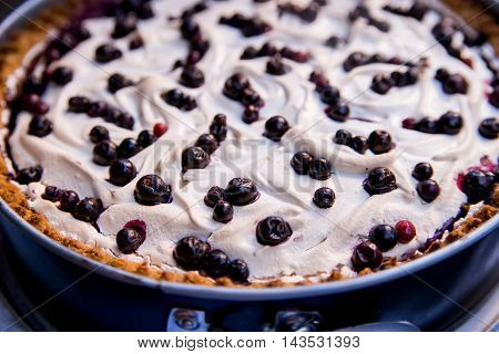 Puff pastry berry pie with sugar and eggnog top
