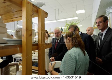 ST. PETERSBURG, RUSSIA - AUGUST 9, 2016: Vice-governor of St. Petersburg Igor Divinsky during his working visit to the Imperial Porcelain Manufactory. The enterprise was founded in 1744