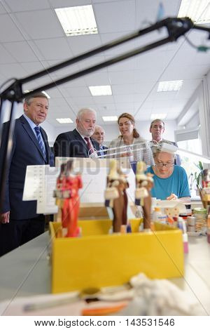 ST. PETERSBURG, RUSSIA - AUGUST 9, 2016: Vice-governor of St. Petersburg Igor Divinsky (2nd from left side) during his working visit to the Imperial Porcelain Manufactory. The factory founded in 1744