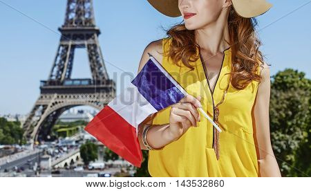 Young Woman In Bright Blouse With Flag In Paris, France