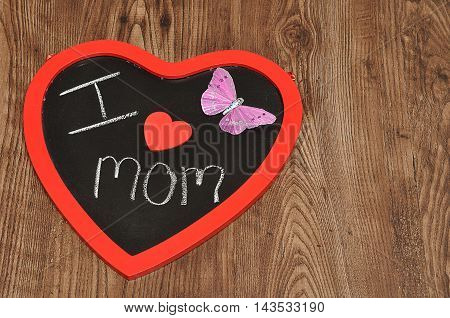 I love mom written on a blackboard decorate with a pink butterfly