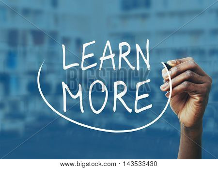 Male hand writing text learn more on screen. Business training concept.
