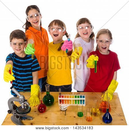 Group of smiling kids standing on the table in protective glasses and gloves showing a chemical test tubes, isolated on white