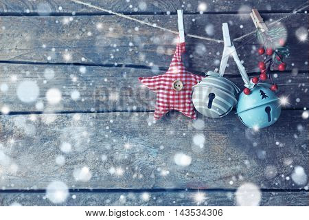 Beautiful Christmas toys on old wooden background. Snow effect