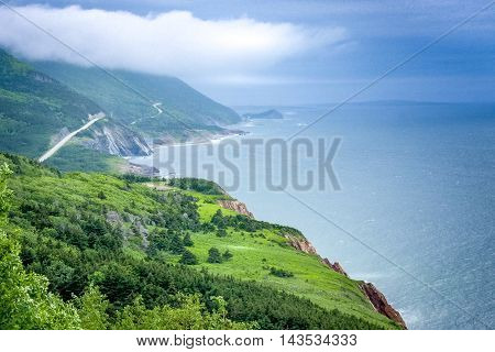 scenic green land and road of Cape Breton ,Highlands National Park, Nova Scotia ,Canada