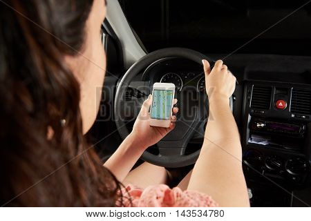 Driver Using Map On Smartphone